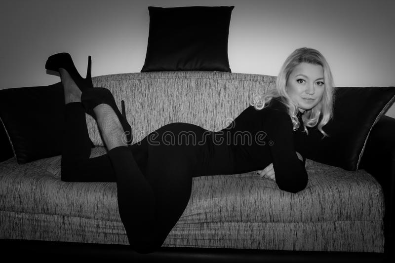 Blonde in black royalty free stock image
