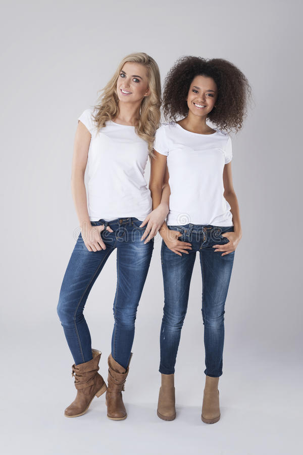 Blonde and blackhair women royalty free stock photography