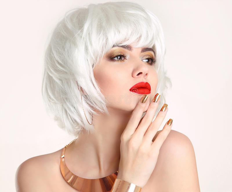 Blonde bob hairstyle. Blond hair. Fashion Beauty Girl portrait. Red lips. Manicured nails and Make-up. Jewelry set. Vogue Style Woman isolated on white stock photography