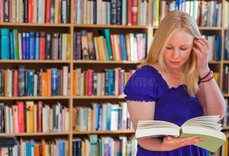Blonde bookreader in study stock photo