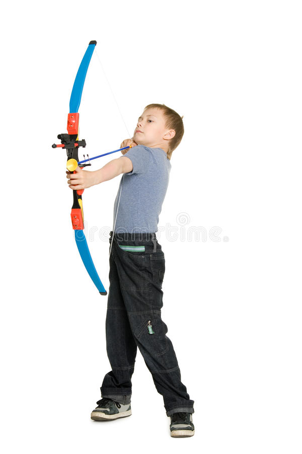 Blonde boy shooting a bow stock photo