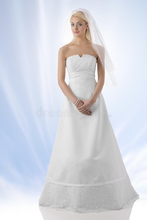 Blonde bride with veil in full lenght