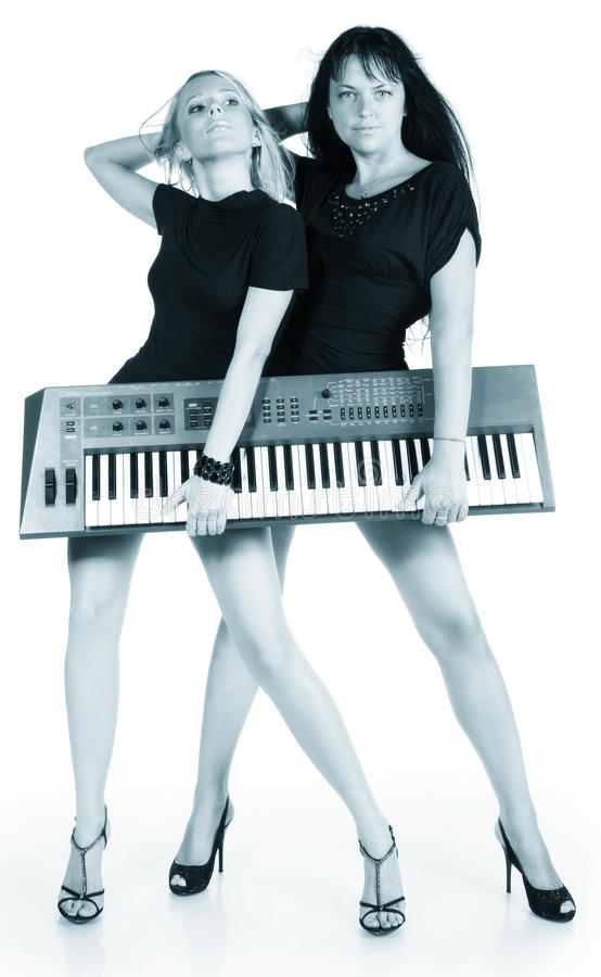 Blonde and brunette with electric piano. On a white background stock photos