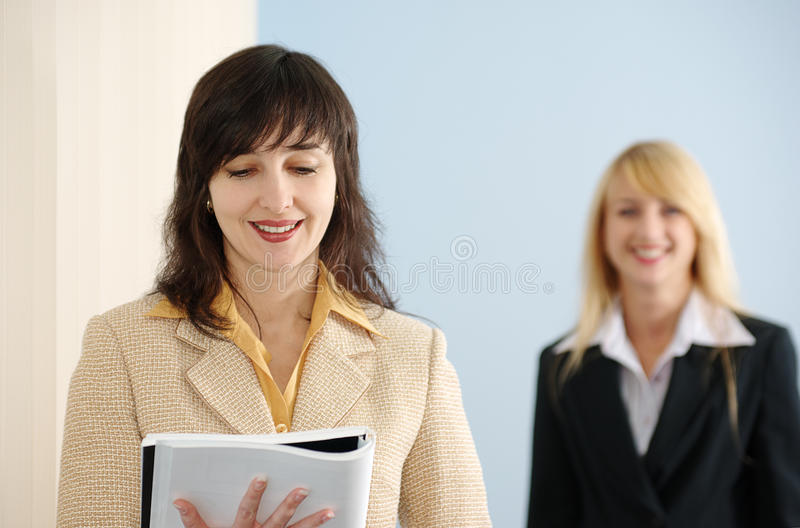 Blonde and brunette women stock images