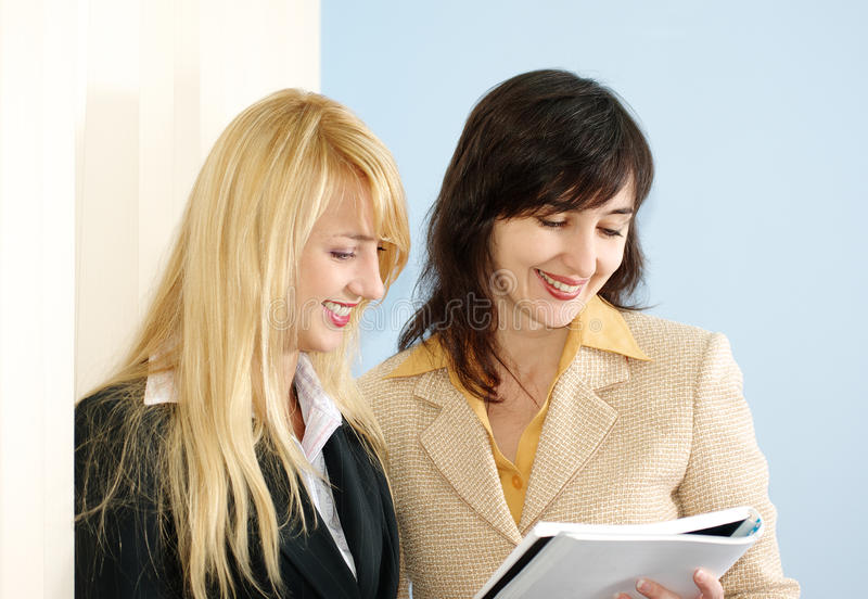 Blonde and brunette women royalty free stock photos