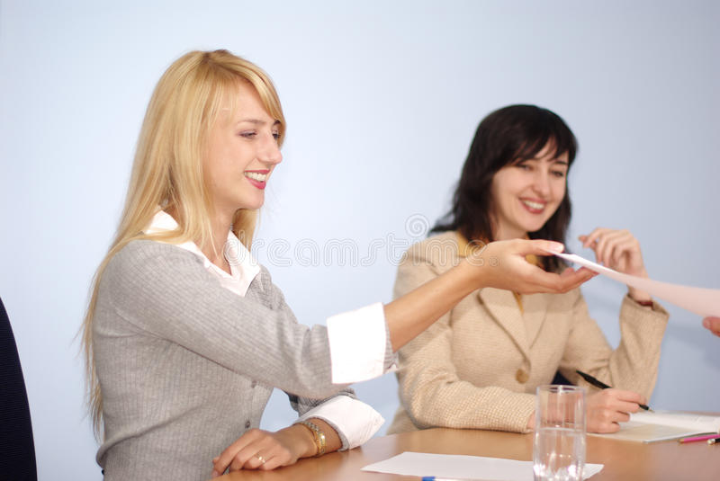 Blonde and brunette women stock photography