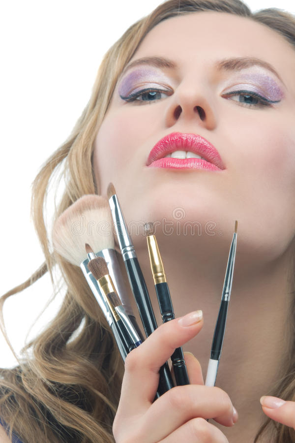 Blonde with a bunch of makeup tools