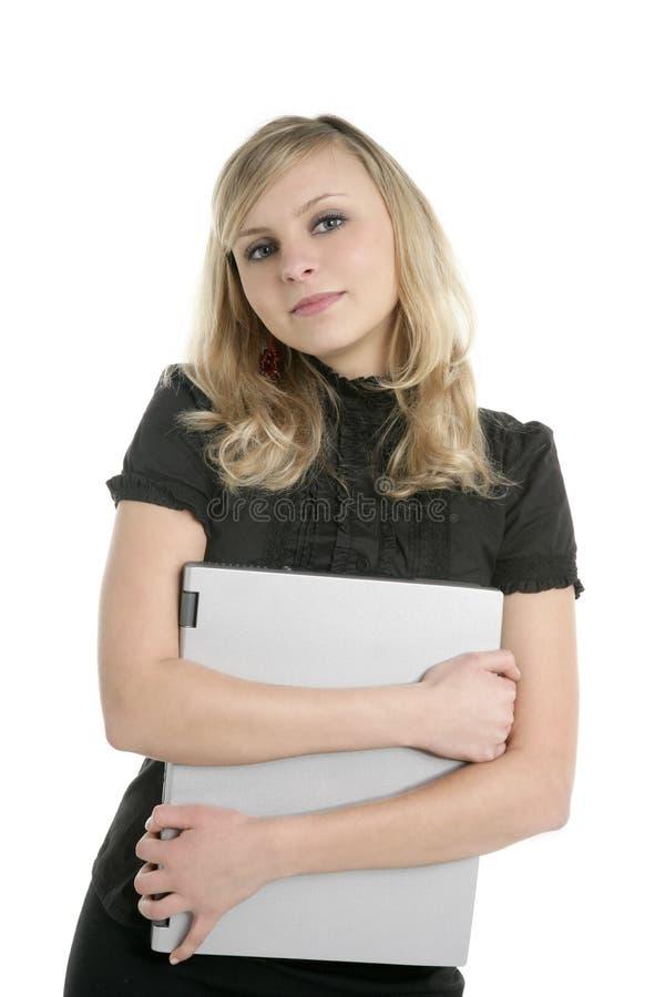 Blonde businesswoman holding laptop computer royalty free stock image