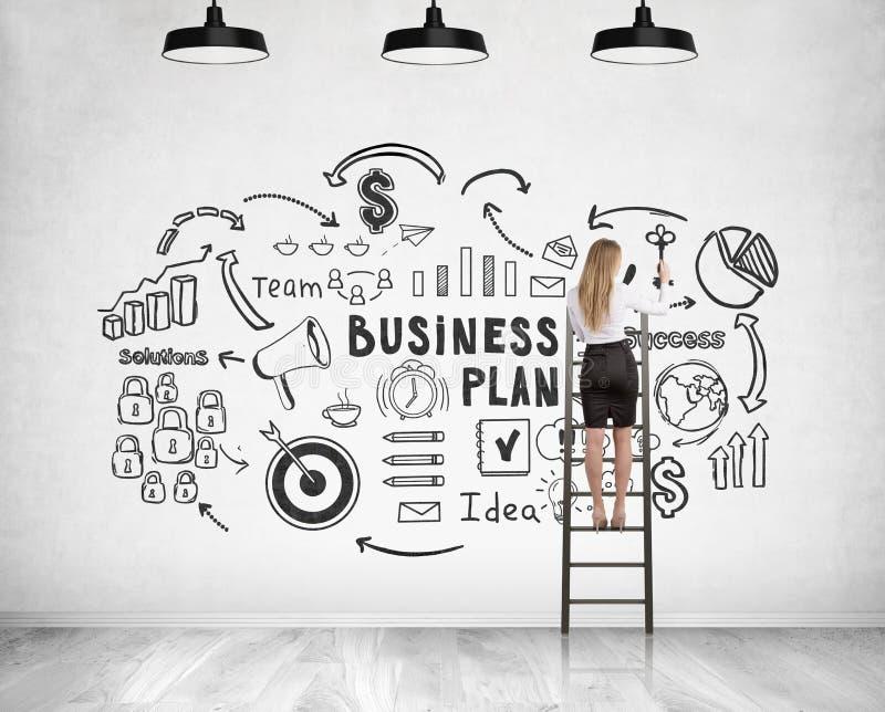 Blonde businesswoman on ladder, business plan stock photos