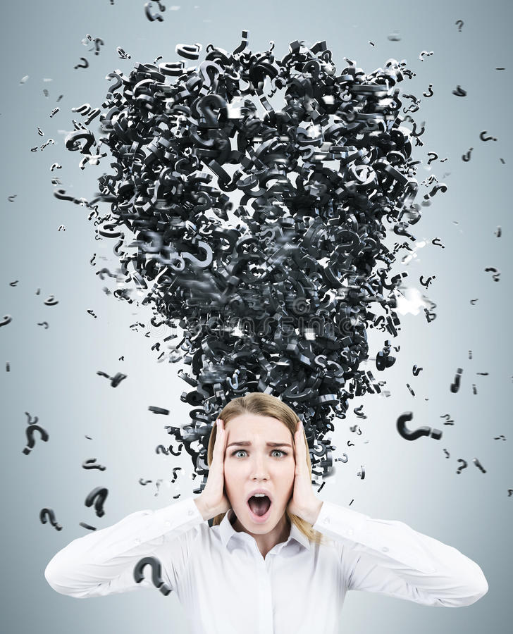 Blonde businesswoman and a question mark tornado. Terrified blonde businesswoman wearing a white blouse standing against a gray wall with a question mark tornado stock image