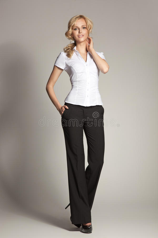 Blonde businesswoman relaxing during lunch time royalty free stock photography