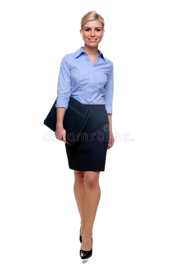 Blonde businesswoman walking towards stock photo