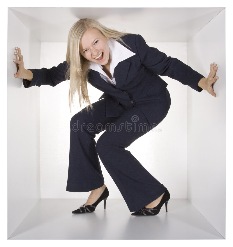 Blonde businesswoman in the white cube. Blonde screaming businesswoman in the white cube stock images