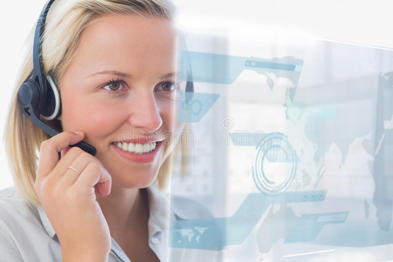 Blonde call center worker using futuristic holographic interface stock image