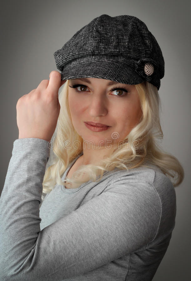 Blonde with cap royalty free stock photo