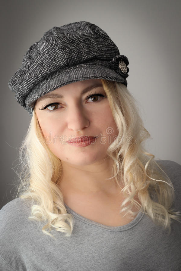 Blonde with cap stock image