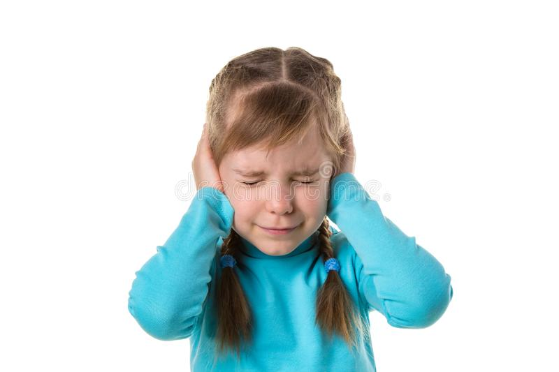Blonde caucasian young girl closing ears with hands, suffering from noise. Isolated over white background royalty free stock image