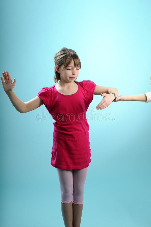 Blonde child practicing dance stock photos