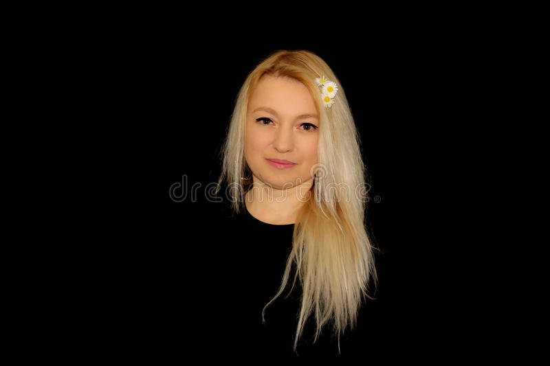Blonde and daisies stock photo