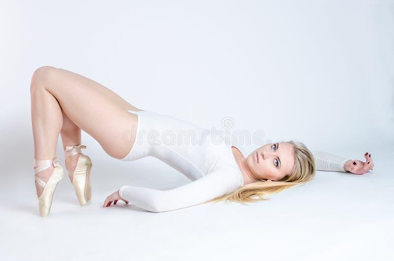 Blonde dancer, ballerina on white background stock image