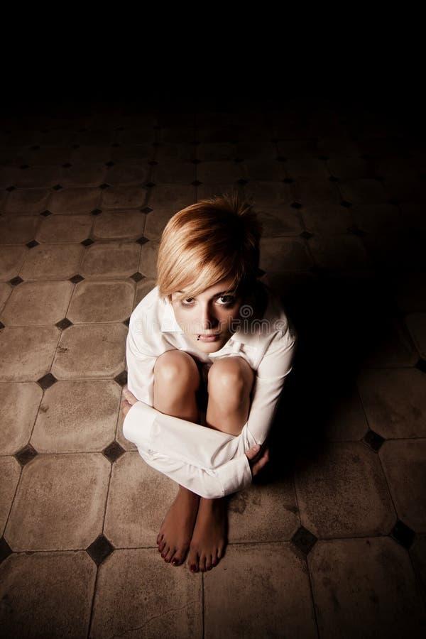 Blonde in darkness stock photos