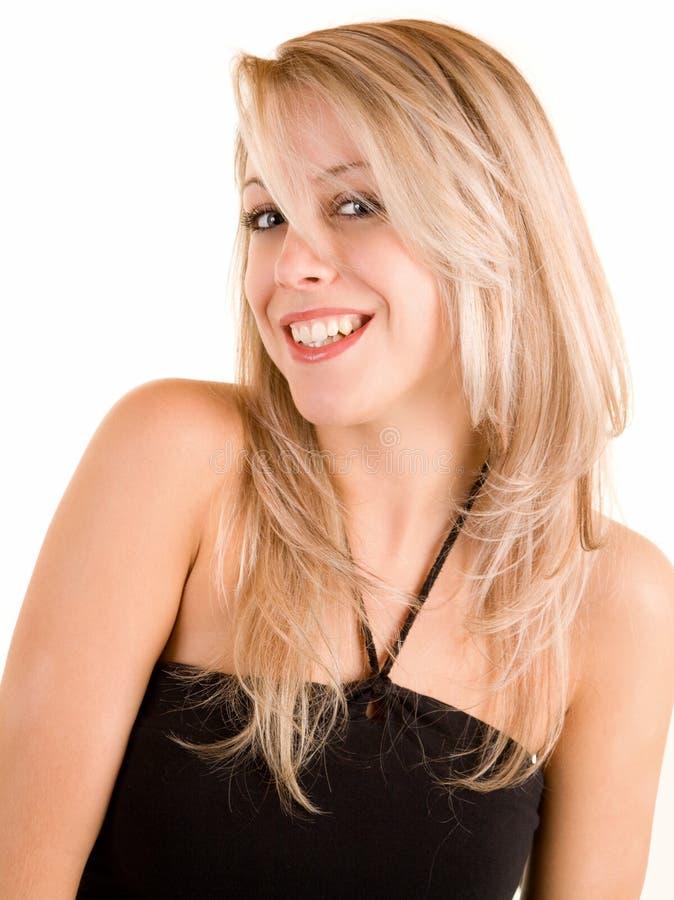 Blonde de sorriso bonito isolado no branco foto de stock