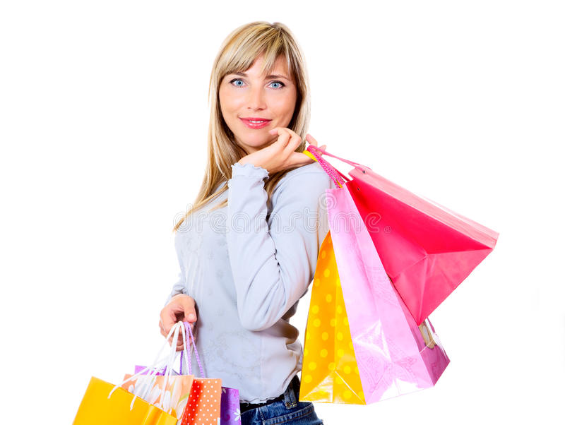 Blonde de sorriso com sacos de compra imagens de stock royalty free