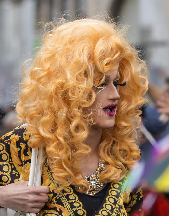 A blonde drag queen attending the Gay Pride parade also known as Christopher Street Day CSD in Munich, Germany. 2019: A blonde drag queen attending the Gay royalty free stock photos