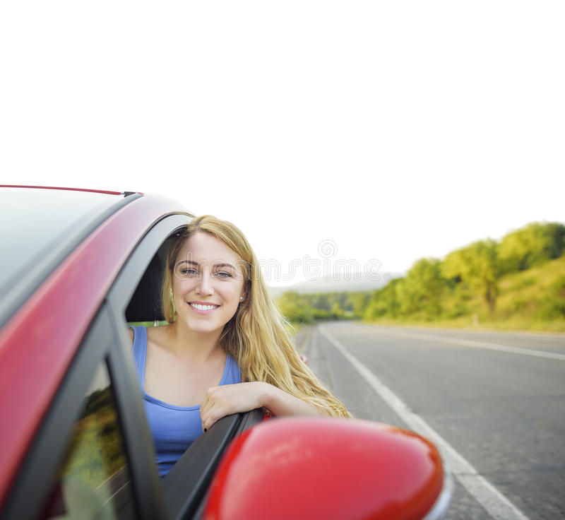Blonde en el coche fotografía de archivo libre de regalías