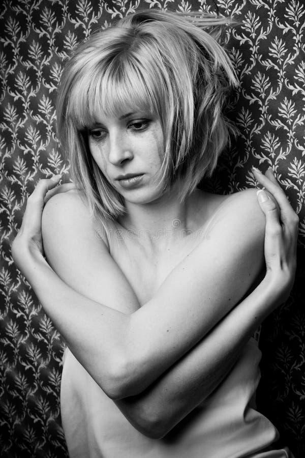 Blonde en rasgones imagen de archivo libre de regalías
