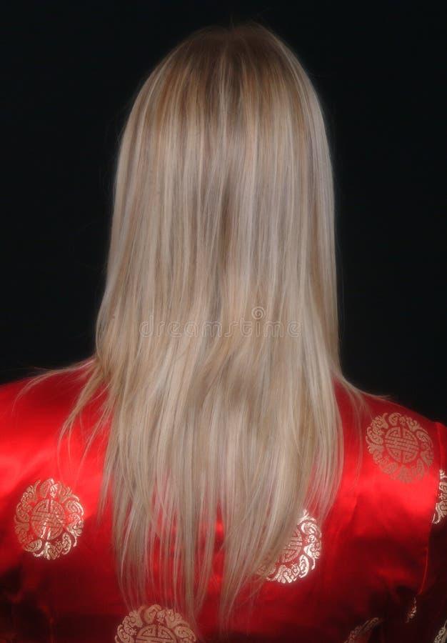 Blonde en rojo fotografía de archivo