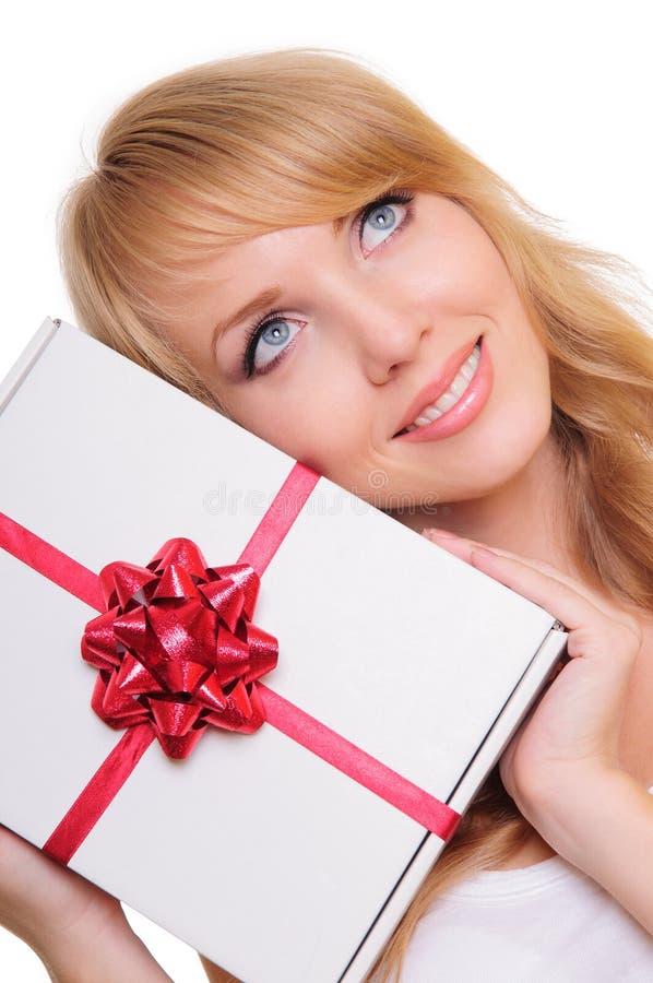 Blonde et un cadre de cadeau photographie stock