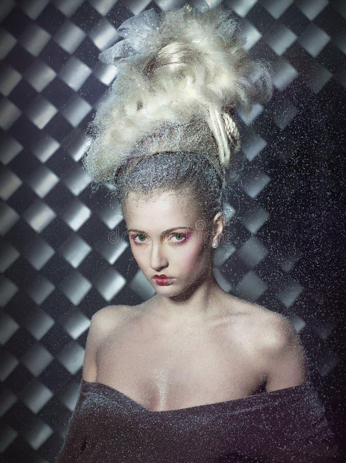 Blonde fantástico na neve. foto de stock royalty free
