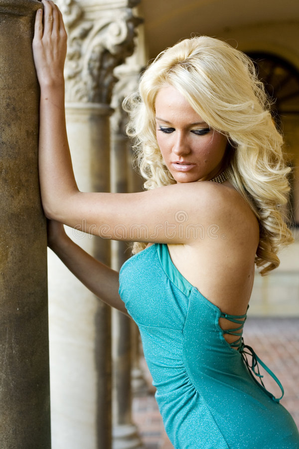 Blonde fashion model. In a formal dress stock image
