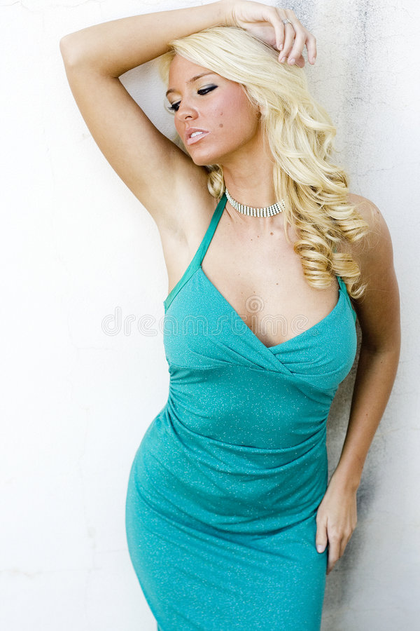 Blonde fashion model. In a formal dress royalty free stock images
