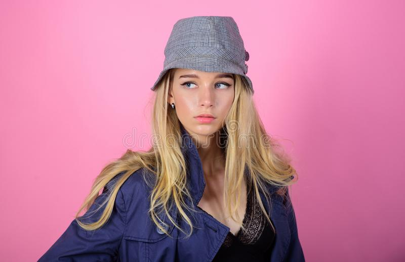 Blonde fashion model on pink background. Woman mysterious face wear hat. Confident and fashionable. Modern style. Girl royalty free stock photos