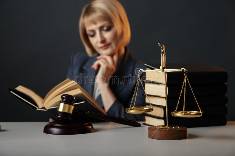 Blonde female advocate at the workplace isolated in studio reading book. Blonde female advocate at the workplace isolated in studio reading book stock images
