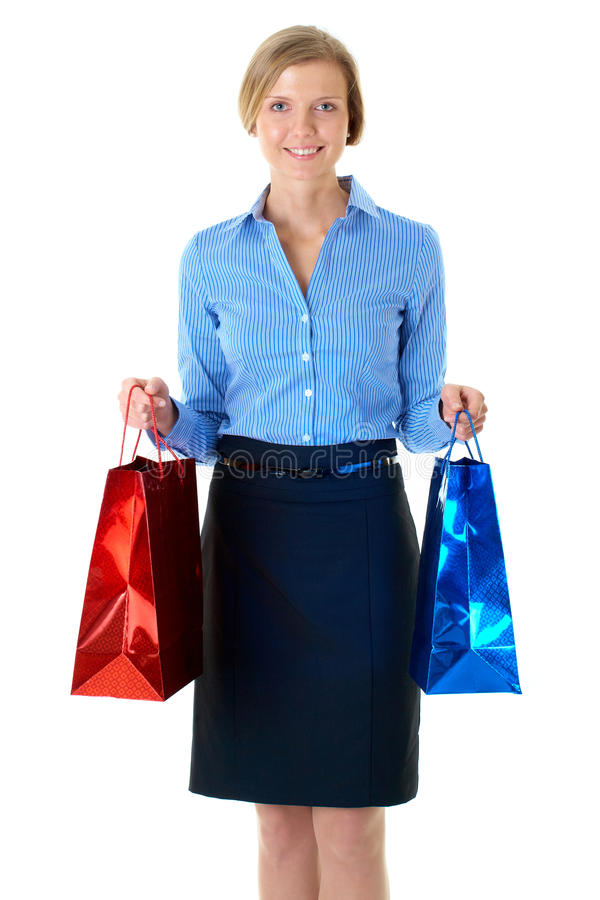 Blonde female carrying two bags, isolated royalty free stock photo