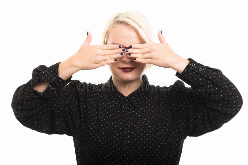 Blonde female teacher wearing glasses covering eyes like blind g stock image
