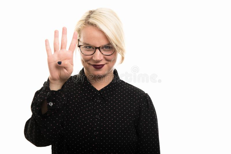 Blonde female teacher wearing glasses showing number four with f stock images