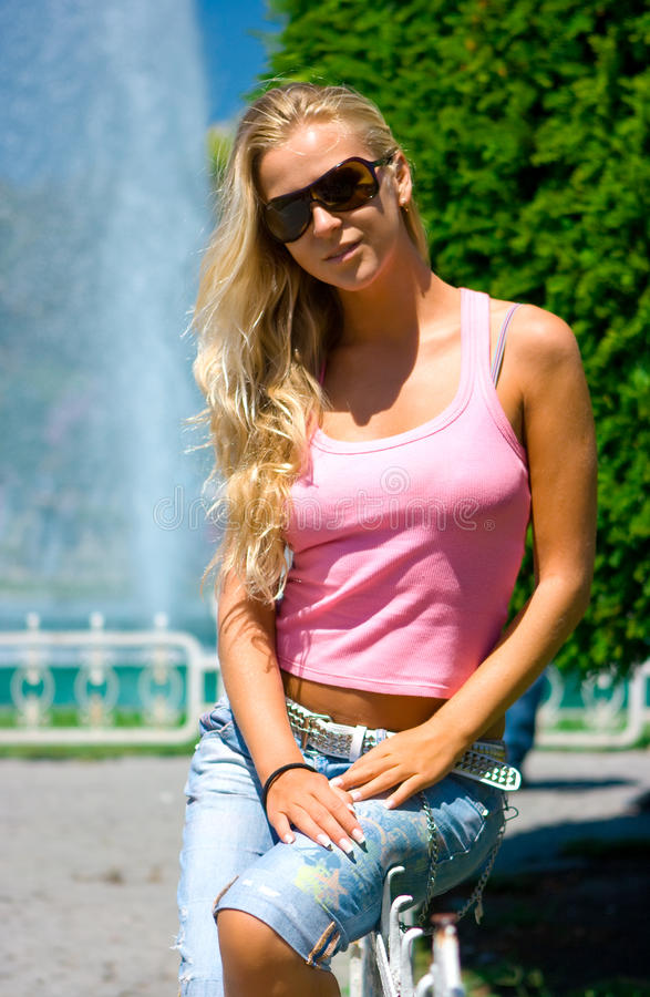 Download Blonde at the fountain stock photo. Image of cute, grass - 10580536
