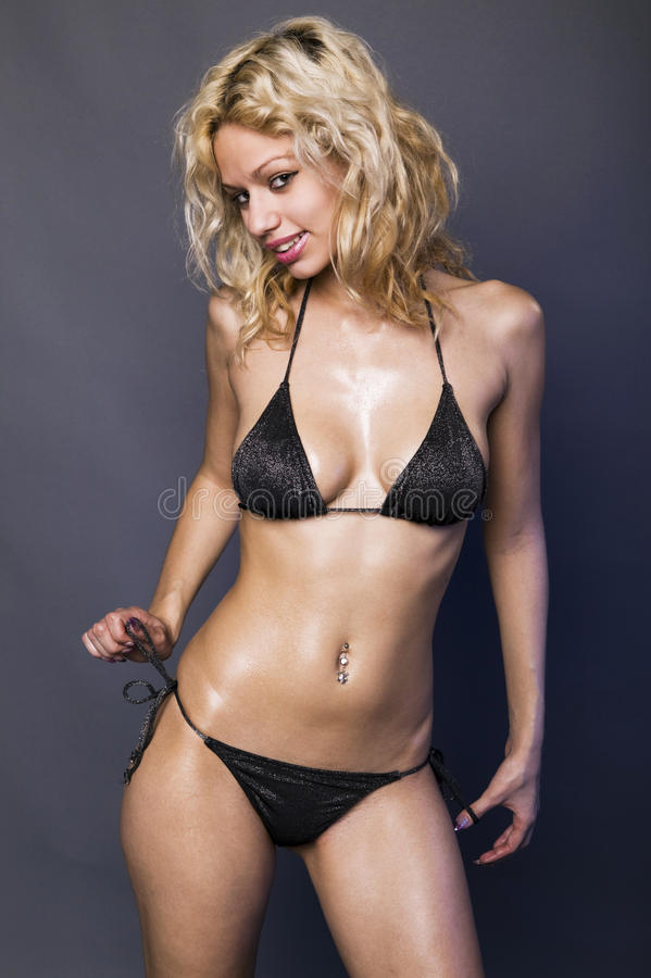 Blonde Girl in Black Bikini stock photography