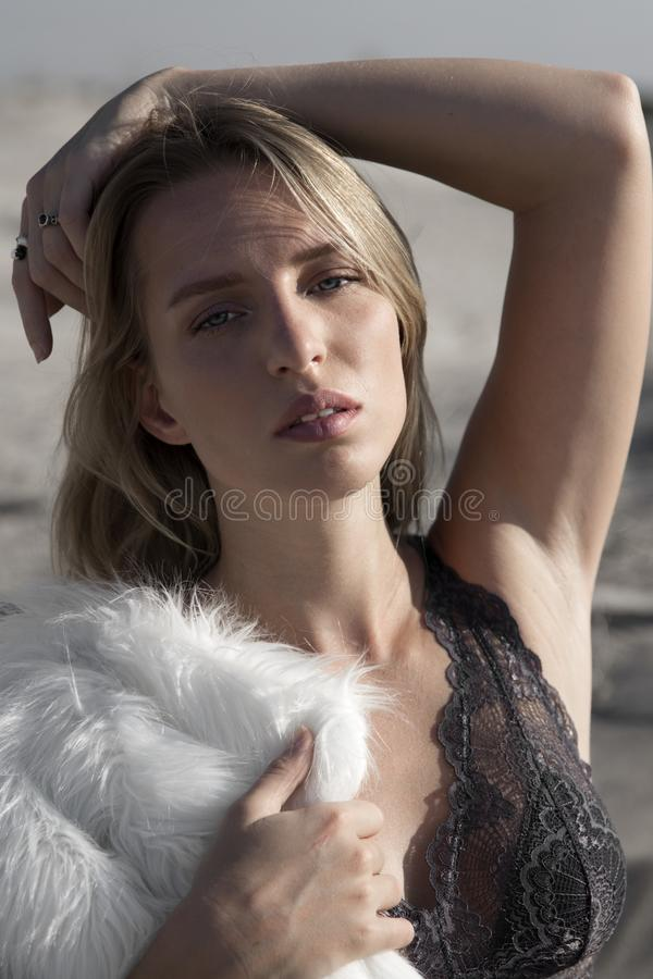 Blonde girl with blue eyes royalty free stock image