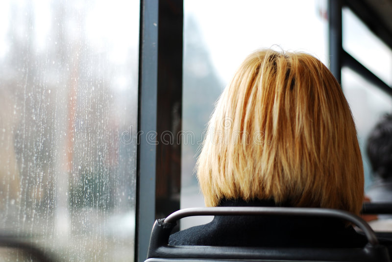 A blonde girl on the bus royalty free stock photography