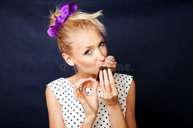 Blonde girl with cake royalty free stock photos