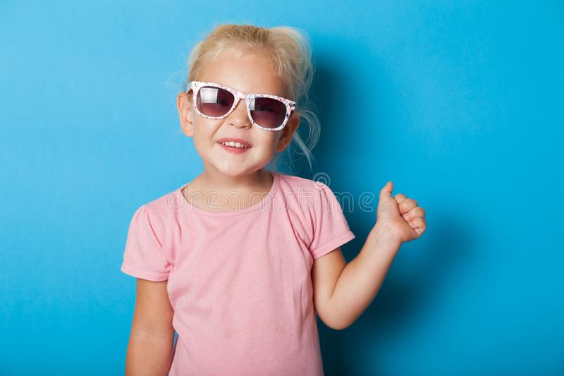 Blonde girl child in sunglasses. Attractive fashion kid royalty free stock photos