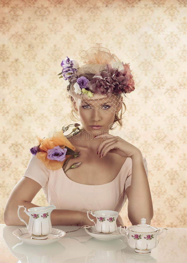 Blonde girl with classical tea set and hand under stock images