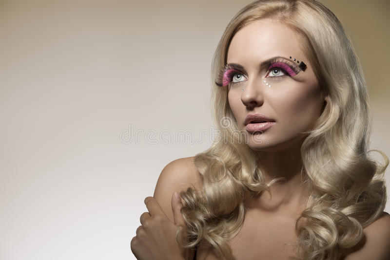 Blonde girl with creative make-up royalty free stock photos