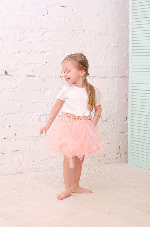 Blonde girl dancing royalty free stock photos