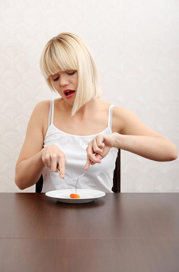 Download Blonde Girl Eating Her Diet Meal. Stock Photo - Image: 21587512